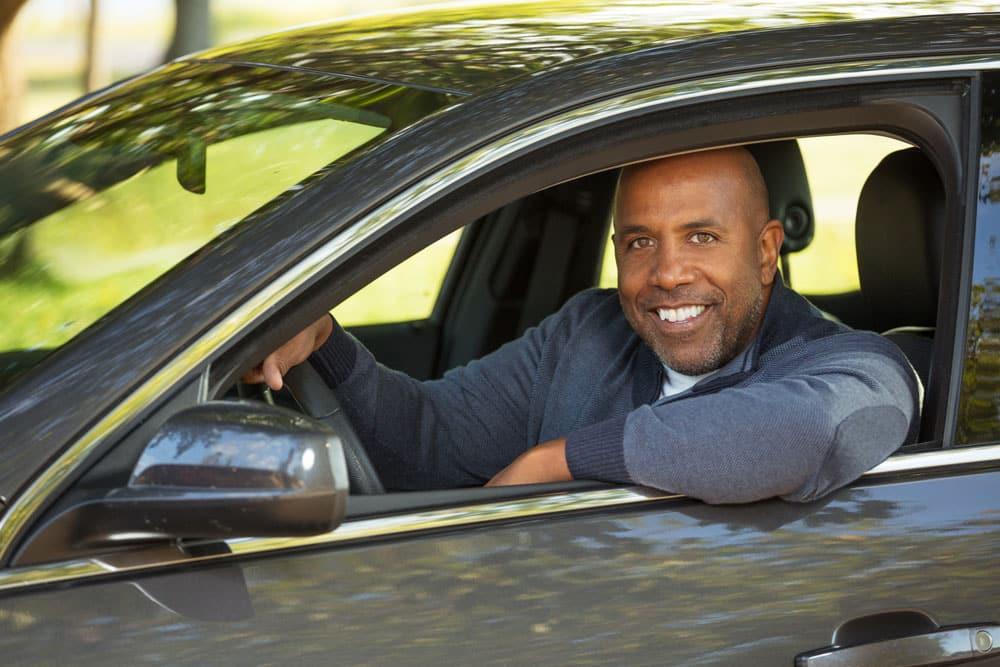 Man driving an EV